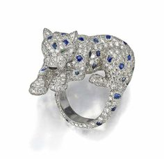 """A diamond, sapphire and emerald """"Panther"""" ring, Cartier"""