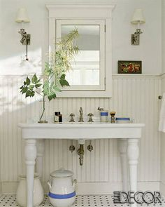 The sink fittings are from Restoration  Hardware, and the ironstone urns are vintage. Click here  to see the resources.