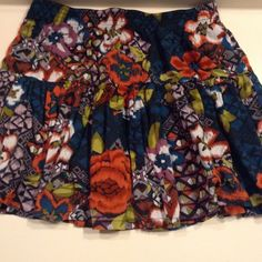 Multicolored Tribal/Floral Patterned Skirt Purple, Orange, Lime, White, Black, Turquoise Floral and Tribal Flowy Skirt with a band around the waist Size Medium Never Worn from Forever 21 Forever 21 Skirts