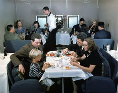 A rare colour photo of dinner aboard the Pan American Boeing B-314 'Clipper' flying boat. Late 1939 to 1943.