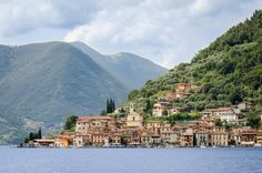 Just a two-hour drive from Milan, you could easily mistake Lake Iseo for the famed Lake Como—if it weren't for the town's inexpensive lodging and lack of crowds. Old Windmills, Visit Italy, Lake Como, White Sand Beach, World Heritage Sites, The Locals, Tourism, National Parks, Places