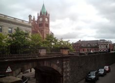 Magazine Gate in the Derry walls, The Guildhall and the Northern Bank building. Ireland.