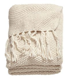 moss knit blanket...blankets are the perfect gift for anyone. They can be paired with other items to make a more personalized gift: pair with a picnic basket to create a romantic date in the park. Pair with junk food for a cozy winter/fall date night at a drive in movie (or movie on the couch). Pair with a telescope or star guide for a romantic night under the stars :)