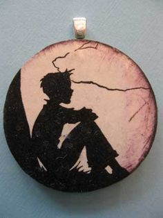 Handmade silhouette image of a boy sitting under a tree. $8.99