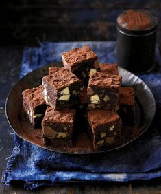 Brownies are the ultimate indulgence for chocolate lovers. These ones are made more decadent with three types of chocolate and pecans. Gourmet Desserts, Plated Desserts, No Bake Desserts, Dessert Recipes, Dessert Ideas, Chocolate Recipes, Chocolate Lovers, Chocolate Cakes, Chocolate Chip Biscuits