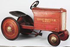 """""""Graham-Bradley Junior Tractor"""" decals on both sides. Seat has some scratching and wear and metal has some pitting, especially on hood. Condition (Very Good). Size 43"""" L. Note: Wheels are made like the Steelcraft Pedal car wheels."""