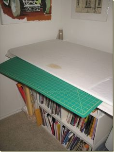 Great idea for a combined pressing surface and cutting table.  The cutting mat slides under the pressing surface.