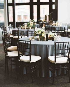 These reception table settings included slate-gray linens to accentuate the neutral color schemes and warm wood tones of the reception venue. Grey Tablecloths, Blue Tablecloth, Wedding Tablecloths, Wedding Table Linens, Wedding Table Settings, Wedding Tables, Black Tablecloth Wedding, Wedding Receptions, Slate Wedding