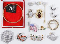 Lot 565: Swarovski Signed Jewelry Assortment; Including pins, earrings and bracelets