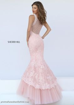 Stunning light pink prom dress. Elaborate prom dress. Pink prom dress with pearls and lace. Scalloped bottom. Prom dress with pearls. Unique prom dress. Pink evening gown.