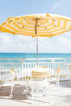 Yellow and white striped pool umbrella