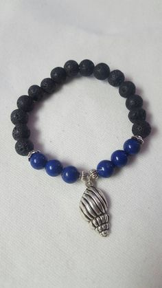 Check out this item in my Etsy shop https://www.etsy.com/ca/listing/493610770/lava-rock-and-lapis-lazuli-beaded