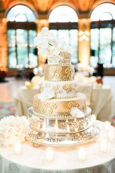 Regal Gold and Champagne Wedding Cake   The Breakers Palm Beach https://www.theknot.com/marketplace/the-breakers-palm-beach-palm-beach-fl-247894   Shea Christine Photography https://www.theknot.com/marketplace/shea-christine-photography-west-palm-beach-fl-546297