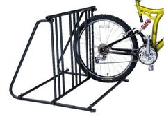 The bike valet bicycle parking rack is a light duty steel bike parking stand for up to six bikes. Features thick powder coated finish for indoor or outdoor use, and is perfect of garage or backyard use. Fits both wide and narrow tire sizes, and easi Bike Parking Rack, Car Bike Rack, Bike Stand For Garage, Thule Bike, Storage Sheds For Sale, Bicycle Stand, Bike Storage, Garage Storage, Bikes For Sale