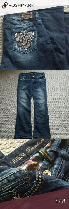 """GUESS JEANS Excellent condition size 28 with an inseam of 31 and with the waist flat 17"""" tag says boot cut and a tag that says stretch these have only been worn a few times lots of studs these could be worn up or worn down these are GUESS PREMIUM JEANS ALL REASONABLE OFFERS CONSIDERED ? Guess Jeans Boot Cut"""