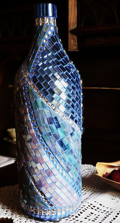 Blue Bottle - finish 004 by Mosaikstall, via Flickr. Mosaic bottle. The blue grout adds to the beauty of this!