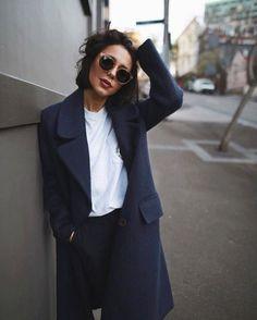 Women wearing knit navy coat for winter work coats.
