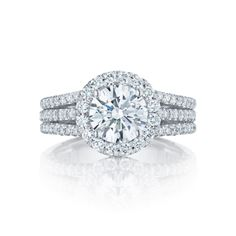 With not one, not two, but three stunning diamond filled bands leading their way up to the brilliant round center diamond, this Tacori engagement ring is absolutely breathtaking. For the Tacori girl looking to make a bold statement, this engagement ring offers a classic round center diamond with an ultra-feminine bloom bringing life to the center stone. Nothing says  'I love you' quit like a triple strand Tacori engagement ring.