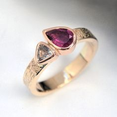 Rubelite and white sapphire gold ring