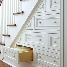 Under the stair storage... I wish I had these!