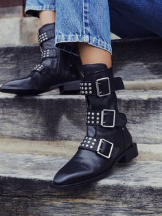 Derringer Ankle Boot | Luxe leather ankle boots in an edgy moto style with metal studs and statement buckle detailing. Modern square toe and stacked heel.