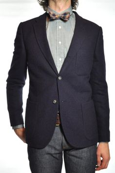 Legacy deep blue Angora three button blazer with a slim fit and patch pockets. Unlined with white piping. from Penelope's