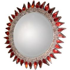 Line Vautrin is one of our favorite designers, this mirror is a perfect example of her funky glamorous jeweled style