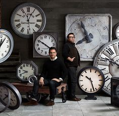 A wall of clocks set to different time zone depicting our customers and sources