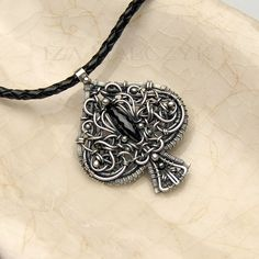 Ace of Spades necklace by Iza Malczyk - silver, spinel, leather.
