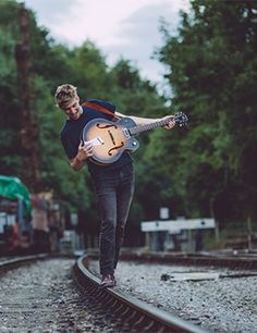 Budapest by George Ezra is just the cutest song.  It's very folky, but the rhythm is just so inventive and fun!