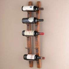 Blackburn 5 Bottle Wall Mounted Wine Rack A Blackburn 5 Bottle Wall Mounted Wine Rack will be an excellent accent to your dining zone or kitchen area. Accomplished idea as a gift for friends. Fits to any decor.