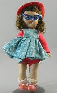 Vogue Ginny Doll Walker Brunette Tagged Dress Glasses Hat  http://cgi.ebay.com/ws/eBayISAPI.dll?ViewItem=370601887885=ADME:L:LCA:US:1123#ht_3478wt_754