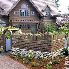 charming cottage made even more so by the stone & shingle fence