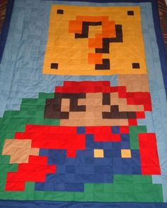 GEEKTASTIC QUILTS    These awesome video game blankets have been quilted into reality with love and care. The Super Mario Brothers-inspired blankets are make from a series of 2 inch cotton squares and are the perfect thing to keep you warm while you're