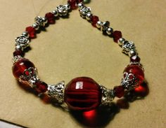 Ruby red glass and silver detail handmade bracelet with lobster clasp by SpryHandcrafted on Etsy Handmade Beads, Handmade Bracelets, Handmade Gifts, Red Glass, Ruby Red, Rose Quartz, Bronze, Pearls, Crystals