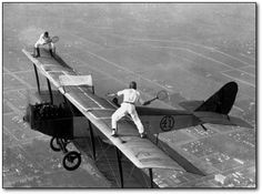 Barely 20 years after the invention of the airplane, mankind started doing shit like this. This 1925 photo depicts a male and female daredevil pretending to play tennis on the wing of a biplane.