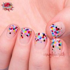Add a bit of color to your short nails with a simple dotting tool.