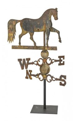 "Sold $12,000 New England cast iron prancing horse weathervane, 19th c., with the original directionals and wooden spacers, horse - 18 3/4'' h., 25 1/4'' w.  Condition 47"" h. (base to top of head). Old finish, probably original. Bullet holes to tail. 1 1/2"" x 1"" loss to rear of one knee. Maker unknown."