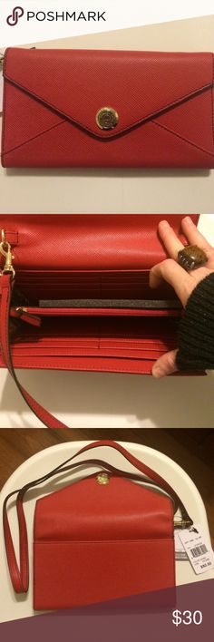 Red London Fog crossbody phone wallet. Red with gold accents.  Crossbody strap clips on and off.  Holds large smart phones (8 x 5).  New and never used. London Fog Bags Crossbody Bags