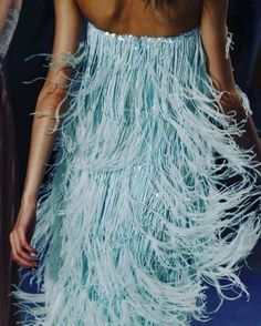 Swish. Aquamarine fringe from Oscar de la Renta Spring 2012. With a colorful sense of modern elegance and a nod to fashion, Lee Jofa's third collection from  Oscar de la Renta reflects an eclectic sensibility and the essence of Mr. de la Renta's style: always distinctive and exceptionally chic. The collection pays homage to Mr. de la Renta's incredible flair for mixing styles, creating an exclusive collection of sophisticated and timeless fabrics and wallcoverings.