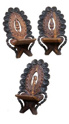 Africa | Three chairs from the Congo | Wood | ca. 1940