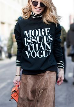 "Street Style - all of the must-see winter outfits from NYFW 2015 -   ""more issues than vogue"" sweatshirt worn over a striped black and white turtleneck, styled with a 70s style, brown suede midi skirt + bright orange leather bag"