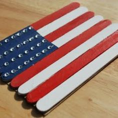 American flag craft for Fourth of July.  Made with craft sticks and paint.