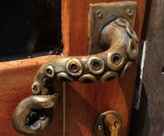 Give your home's facade a fun nautical touch by outfitting your front door with this custom made octopus handle. The twisted tentacles expose suckers that come coated with brass powder for a distinguished antique feel.