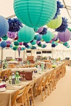 purple and aqua round paper lanterns hanging with poms