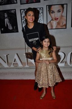 Jacqueline takes a quick picture with Ratnani's daughter.