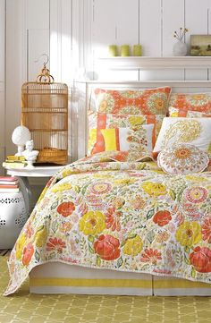 Love the yellow and orange floral print on this gorgeous bedding. It's perfect for spring.