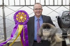 Owner and handler David Fitzpatrick with his Pekingese dog Malachy, winner of Best in Show at 136th Westminster Kennel Club show, visits The Empire State Building on February 16, 2012 in New York City.