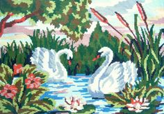Vintage needlepoint tapestry, two swans on water.. dimensions of the embroidered field: 42cm by 30cm = 16.4 by 11.6 It has been cleaned.  Cross stitch