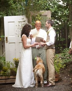 A tennis ball with a slit it in held the rings. When it came time for the couple to exchange their wedding bands, the bride's uncle tossed the ball down the aisle, and Raja promptly fetched it, bringing it to Katie and Jon